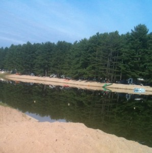 "The lake and ""beach"" at Wassampki Springs Campground."