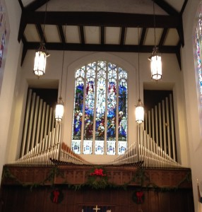 An impressive organ and a gorgeous stained glass window above the altar at Main Street United Methodist Church in downtown Suffolk.