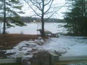 The view of our back yard and dock from the deck at the cottage we rented on Lake Norman. It took a long time for all of the snow to melt because the property is shaded most of the day.