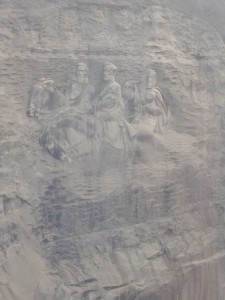 The carving on the side of Stone Mountain is the largest bas relief sculpture in the world. It features three leaders of the Confederate States of America: Stonewall Jackson, Robert E. Lee and Jefferson Davis. The entire carved surface measures 3 -acres, and is 400- feet above ground. The measurements are 90' x 190' and it is recessed 42- feet into the mountain.