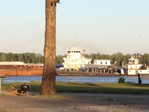 This barge had so much cargo that it needed a tug boat along side to help it down the river.
