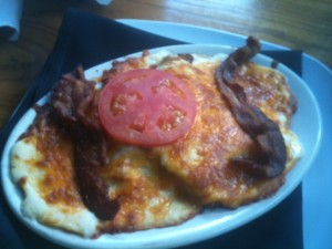 I had to order a 'Hot Brown' in the state where it was invented. It almost made me want to have a hangover while eating it... seemed like the perfect cure with its layers of bread, gravy, roast turkey, sliced ham, melted cheddar cheese, bacon and tomato. SOOO delicious and incredibly unhealthy! That amount of grease and carbs would make anyone feel better if they overindulged the previous night.