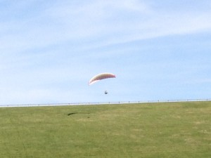 Someone learning how to paraglide on the side of the dam at Caesar Lake State Park.