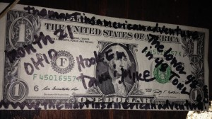I am aware that it is unlawful to deface American currency, but that hasn't stopped us from taping a few $1 bills to the walls of various establishments. This time we left one at The Thurman Café. I remember we left other ones at bars in Rhode Island and Pensacola. Oh yeah, and I left my bra taped to the wall at the Floribama!
