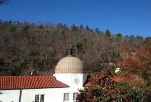 The dome of the historic Quapaw bath house, set against the backdrop of the National Forest.