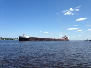 This ship is 1,000 feet long. It is loaded down with iron ore and heading out of the harbor to makes its way across Lake Superior. It has so much cargo that the vessel reaches down another 28 feet under the water.