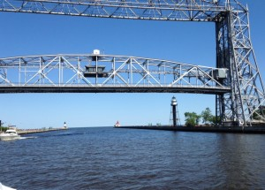 The lift bridge in Duluth connects the Canal Park area to the Park Point Peninsula. Vehicles and pedestrians cross the bridge when it is down. It lifts when boats and ships need to pass under it.