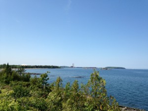 A view of the northern part of Marquette - snapped from the shore by the lighthouse. You can see the Superior Dome, the Power Plant, and Presque Isle. The Ore Docks are there too, just too small to see.
