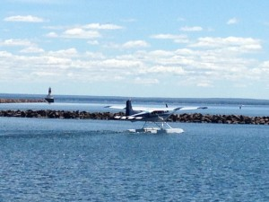 The sea plane taxis out of the Presque Isle Harbor, preparing for take-off.