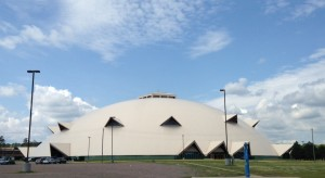 "The Superior Dome, which opened as the ""world's largest wooden dome"" on September 14, 1991, is a domed stadium on the campus of Northern Michigan University. I wonder how high the snow gets on the sides of the buildings in the winter.  I don't think I would want to be there in person to find out."