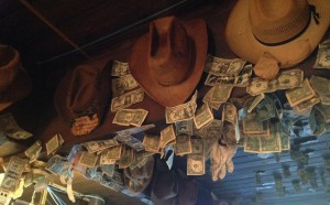 The ceiling beams in the Little Missouri Saloon were covered in dollar bills and cowboy hats.