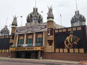 "The World's Only Corn Palace. They call it ear-chitecture. 120 years old. The theme changes every year. ""They"" grow six different colors of corn in separate fields so the hues are not combined. Then they prepare a color-by-number design and start filling in the blanks by affixing ears of corn to the exterior of the building. As you can see, the 2015 theme is American Pride."