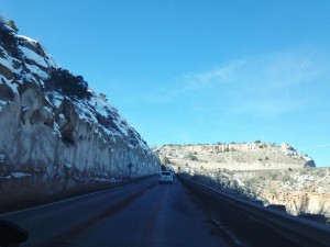 The road into Los Alamos hugs the side of a canyon as drivers ascend.