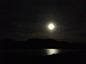 Full moon over the lake on a clear night.