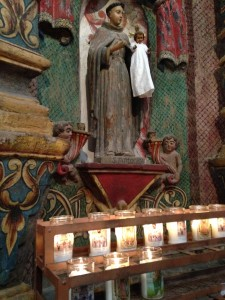 My three candles burning at the feet of St. Anthony at Mission San Xavier del Bac.