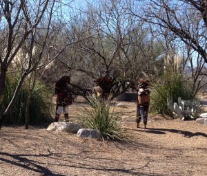 Three mariachis in someone's front yard.