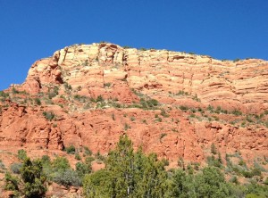 A red mountain behind the Chapel of the Holy Cross.