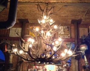 This antler chandelier caught Mike's eye. His dad has a smaller version hanging over the dining room at this folk's house, which he made himself!