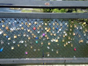 There is a locks of love bridge in Missoula. There are actually tons of locks of love bridges all over in random places. Every time I see one I wonder if the structure of the bridge is compromised with the weight of the locks like the original one in Paris was.