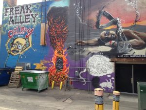 Artists pay the city to paint murals in Freak Alley each year.