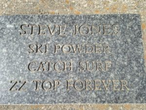 Each tree in the park (and there were hundreds) was dedicated to a person or family. A granite plaque at the base of each trunk signified the memorials. I would have liked to have known Steve Jones.